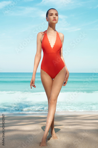 Poster womenART Beautiful sexy woman in red swimwear on the beach