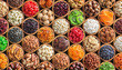 Leinwanddruck Bild - assorted nuts and dried fruit background. organic food in wooden bowls, top view.