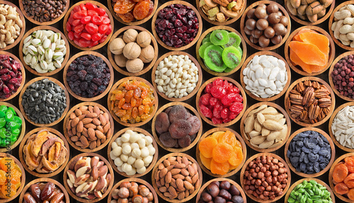 assorted nuts and dried fruit background. organic food in wooden bowls, top view. - 264270456