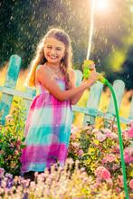 Playfull Girl Watering Flowers...