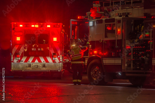 Photographie fire truck, firefighter, ambulance responding to car crash at night