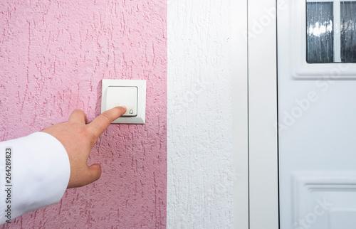Vászonkép hand ringing on doorbell on pvc front door