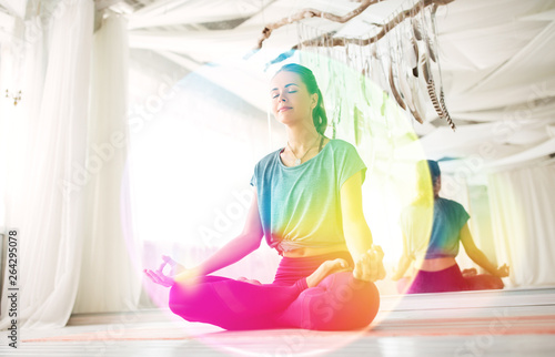 Photo mindfulness, spirituality and healthy lifestyle concept - woman meditating in lo