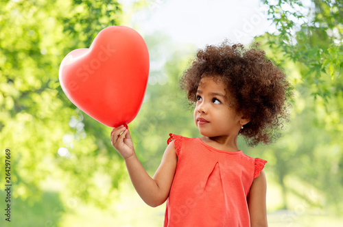 Photo  childhood, valentine's day and people concept - happy little african american gi