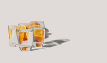 Oranges Behind Glasses Filled ...