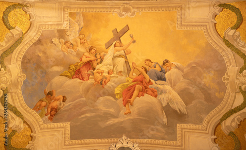 ACIREALE, ITALY - APRIL 10, 2018: The symbolic fresco of Faith cardinal virtue among the angels in Basilica Collegiata di San Sebastiano by Francesco Mancini Ardizzone (1899 - 1901).