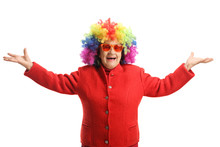 Happy Elderly Lady With A Red Coat And A Colorful Wig