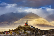 The Maitreya Buddha Statue With Himalaya Mountains In The Background From Diskit Monastery Or Diskit Gompa, Nubra Valley, Leh Ladakh, Northen India.