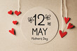 Leinwandbild Motiv 12 May Mothers Day message with handmade small paper hearts