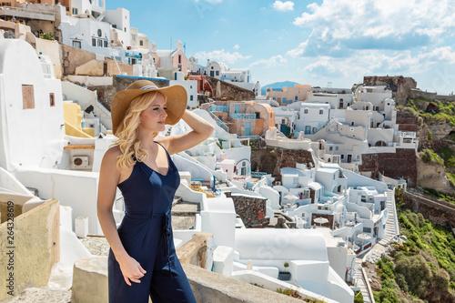 Fototapeta blond woman in Oia on Santorini obraz
