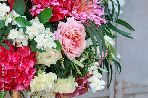 Flower background with roses, peonies, hortensias, carnations and other flowers.