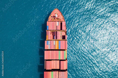 Fototapeta Aerial image of a Container ship at sea, loaded with various container brands. obraz