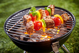 Assorted grilled meat with vegetable on a grill