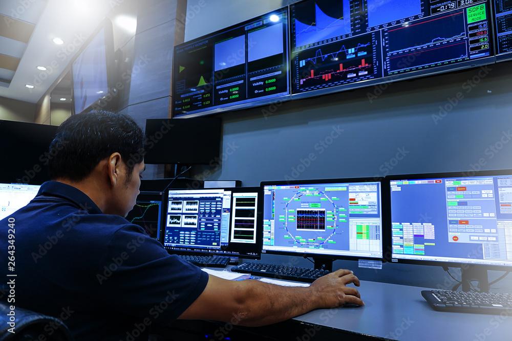 Fototapeta Engineer looking to work in the electrical control room