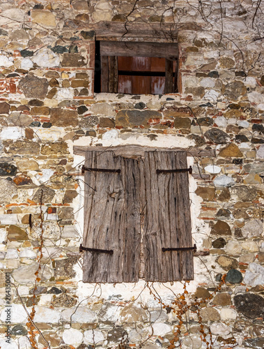 Wooden Window And Shutter On An Old Abandoned Stone House In