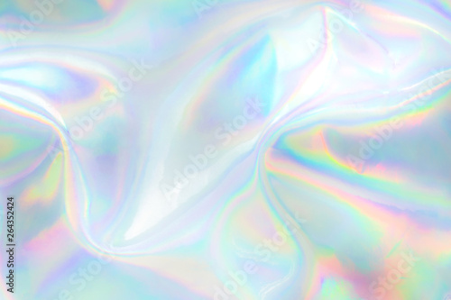Abstract trendy holographic background. Real texture in pale violet, pink and mint colors with scratches and irregularities