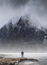 Man Stood In Front Of Foggy Mi...
