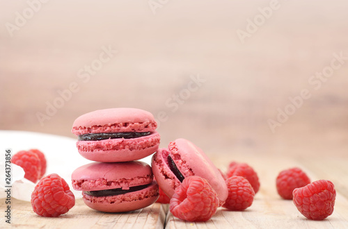 Staande foto Macarons Macarons with raspberry jam closed up