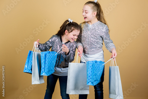 99cf7b9394426 Sale and discount. Shopping day. Children hold bunch packages. Kids  fashion. Expect