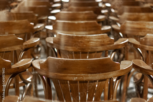 Close Up Clean Shoot Of Arrays Of Wooden Chairs In Old Building Hall