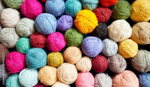 Fotografie, Obraz Colorful background made of many wool yarn balls.
