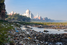 Indias Contrast Of Ugly Pollution And Stunning Beauty, The Banks Of Yamuna River Polluted With Garbage And Beautiful Taj Mahal In The Background
