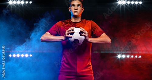 Teenager - soccer player. Boy in football sportswear after game with ball. Sp...