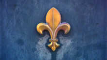 A Weather-beaten Metal Sculpture Of The Fleur De Lis Symbol Attached To A Textured Blue Wall In Horizontal Image Format.