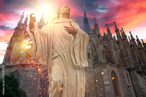 Poster Fantastique Paysage Phantasy holy statue front of church with dramatic sky and glittering effect.