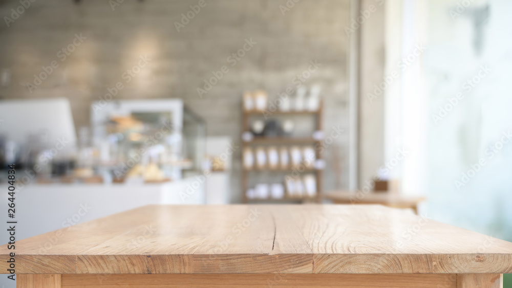Empty top wooden table in cafe background