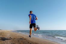 Back Man Athlete Running On Sa...