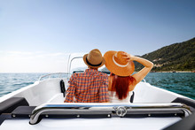 Two Young People On Summer Boat And Ocean Landscape