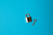 Opened Padlock And Keys Isolated On Blue Background