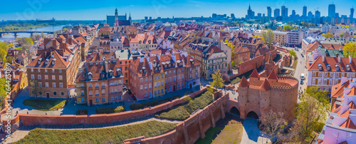 Warsaw, Poland Historic cityscape skyline roof with colorful architecture buildings in old town market square and church tower with blue sky