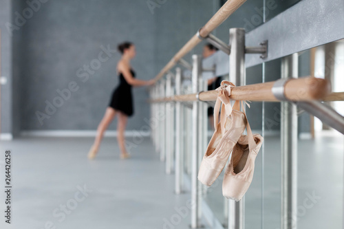 Fotografie, Tablou  Pointe shoes hang on ballet barre