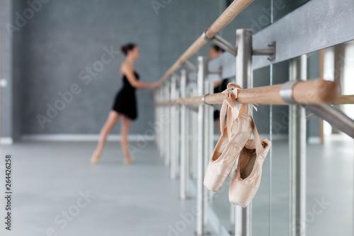 Fotografie, Obraz  Pointe shoes hang on ballet barre