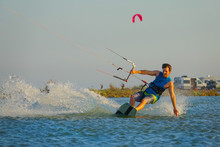 Cool Male Kitesurfer Drags His...