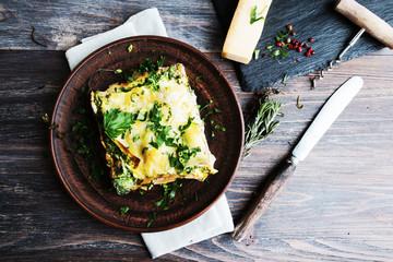 Vegetable lasagne served on ceramic plate - italian cuisine - vegetarian diet. Closeup.