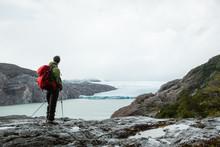 Hiker On Peak Above Sea