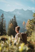Hiker Turns Head To Peaks
