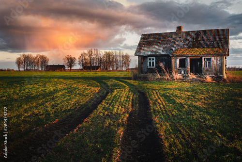 Old abandoned house in the fields. Fototapet