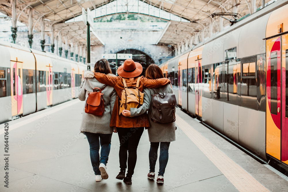 Fototapety, obrazy: .A group of young friends waiting relaxed and carefree at the station in Porto, Portugal before catching a train. Travel photography. Lifestyle.
