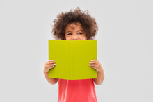 Childhood, Literature And Reading Concept - Happy Little African American Girl With Book Over Grey Background