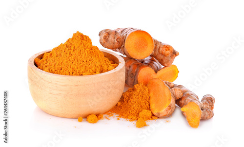 Canvas Prints Condiments turmeric rhizome and powder in blow on white background
