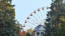 Ferris Wheel Rotates In A Park...