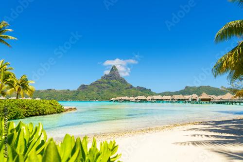 Fotografie, Obraz View on Mount Otemanu through turquoise lagoon and overwater bungalows on the tropical island Bora Bora, Tahiti, French Polynesia, Pacific ocean