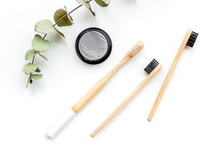 Bamboo Dental Cleaning Brush And Carbon Toothpaste For Zero Waste Lifestyle Concept On White Background Top View