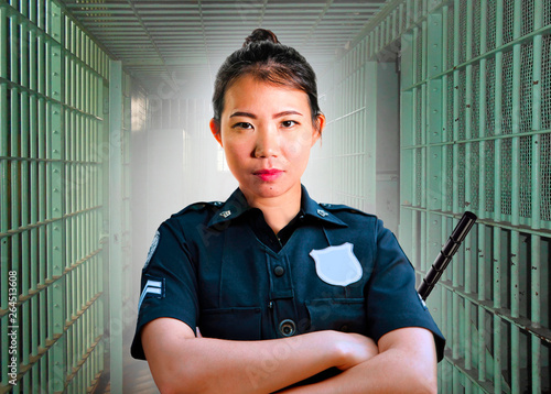 young serious and attractive Asian Korean guard woman standing on cell at State Fototapeta