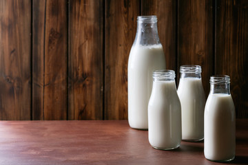 Fresh milk in different glass bottles