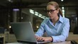 Female employee looking time on wristwatch, frustrated with missed deadline